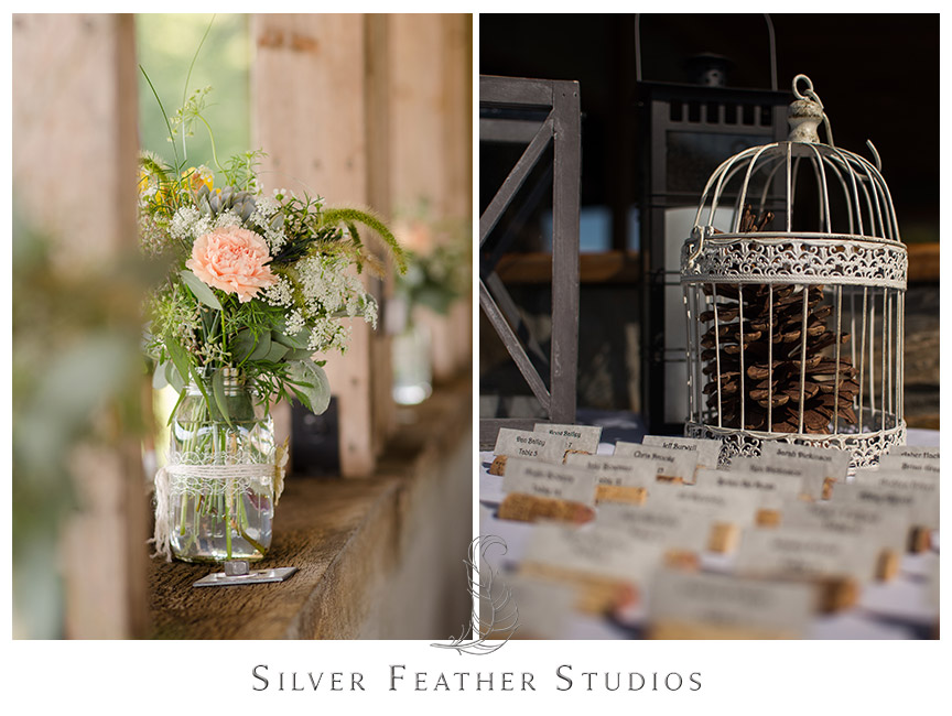 Bird cage and cork escort cards continue the rustic barn theme of this outdoor reception.   © Silver Feather Studios, Burlington, NC Wedding Photography