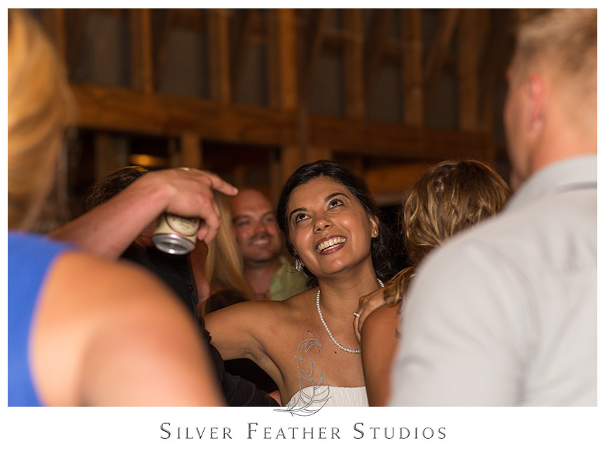 Bride dances at her Starlight Meadow wedding in Burlington NC.  © Silver Feather Studios, Burlington, NC Wedding Photography