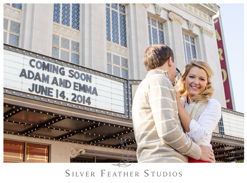 Beautiful downtown engagement session outside the Carolina Theater in Greensboro, NC.    © Silver Feather Studios, Greensboro Wedding Video and Photography
