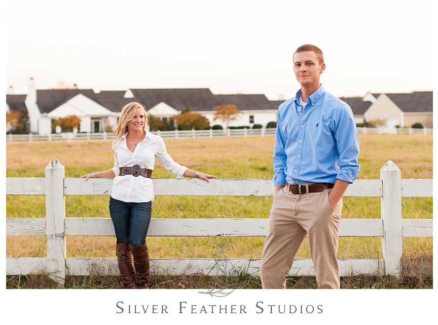 Modern posing on the cow pastures at Fearrington Village for this autumn engagement session. © Silver Feather Studios, Chapel Hill Wedding Videography and Photography