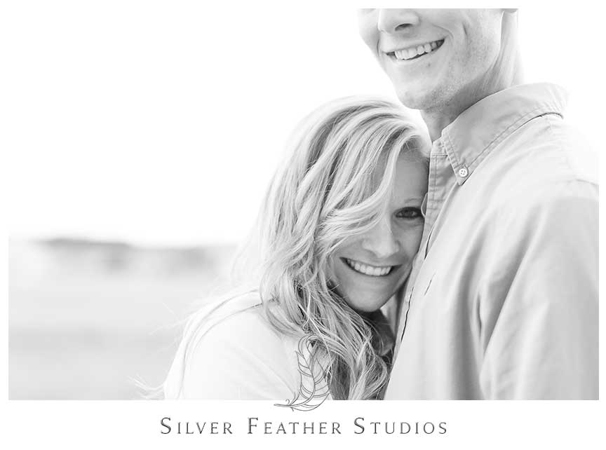 Fun cuddling at this romantic autumn Fearrington Village engagement session.© Silver Feather Studios, Chapel Hill Wedding Videography and Photography