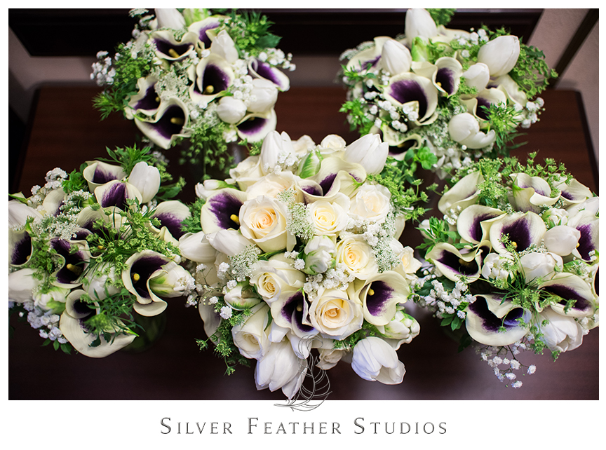 Calla lilies and baby breath bouquets for this wedding in Greensboro, NC by Silver Feather Studios.