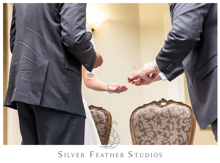 Marcellus and Lisa exchange rings at their Jehovah's Witness ceremony in Greensboro. © Silver Feather Studios, Wedding Photography in Greensboro, North Carolina.