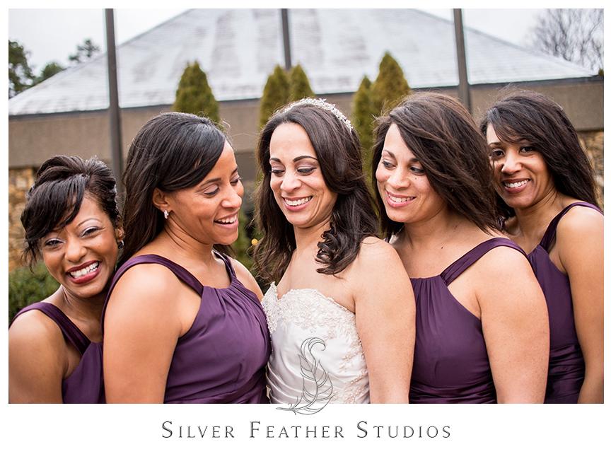 Bridesmaid pose in their purple chiffon dresses at this Bryan Park Golf Center Wedding.© Silver Feather Studios, Wedding Photography in Greensboro, North Carolina.