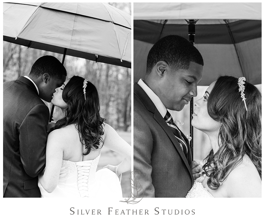 Marcellus and Lisa pose outside in the rain with a black umbrella at their Bryan Park Golf Center Wedding. © Silver Feather Studios, Wedding Photography in Greensboro, North Carolina.