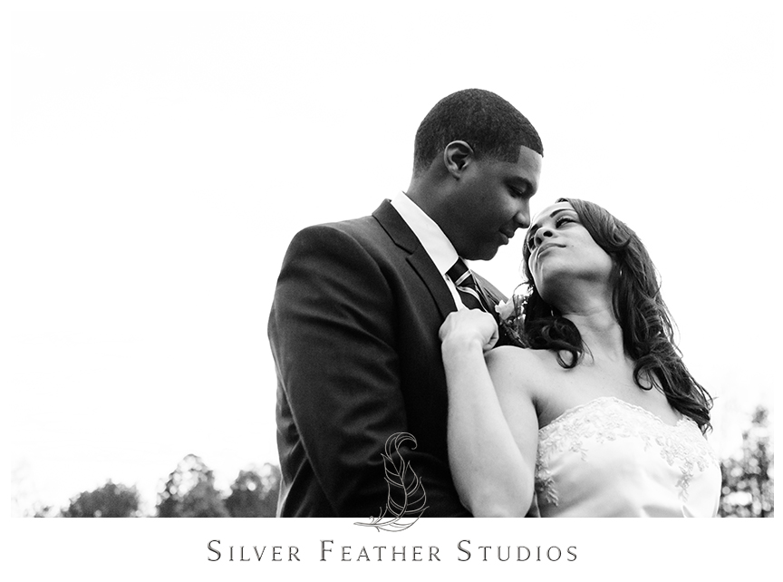 Bride and groom at their purple and grey Bryan Park Golf Center Wedding in Greensboro.© Silver Feather Studios, Wedding Photography in Greensboro, North Carolina.