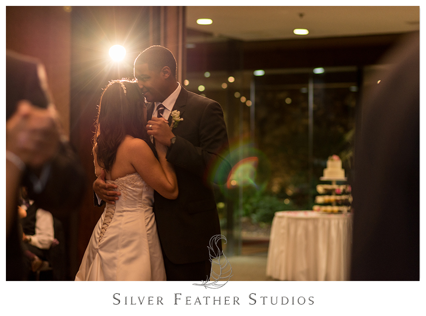 Bride and groom have their first dance at their Bryan Park Golf Center Wedding reception.© Silver Feather Studios, Wedding Photography in Greensboro, North Carolina.