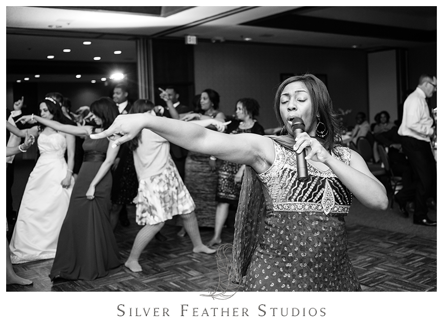 Instructor teaches guests a special dance at this Bryan Park Golf Center Wedding reception.© Silver Feather Studios, Wedding Photography in Greensboro, North Carolina.
