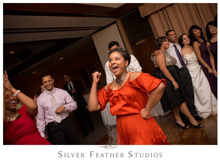 Guests party it up at Bryan Park Golf Center Wedding reception.© Silver Feather Studios, Wedding Photography in Greensboro, North Carolina.