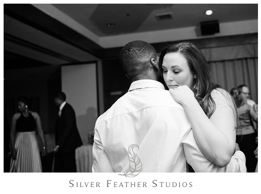 Guests dance at this purple and gray Bryan Park Golf Center Wedding reception.© Silver Feather Studios, Wedding Photography in Greensboro, North Carolina.