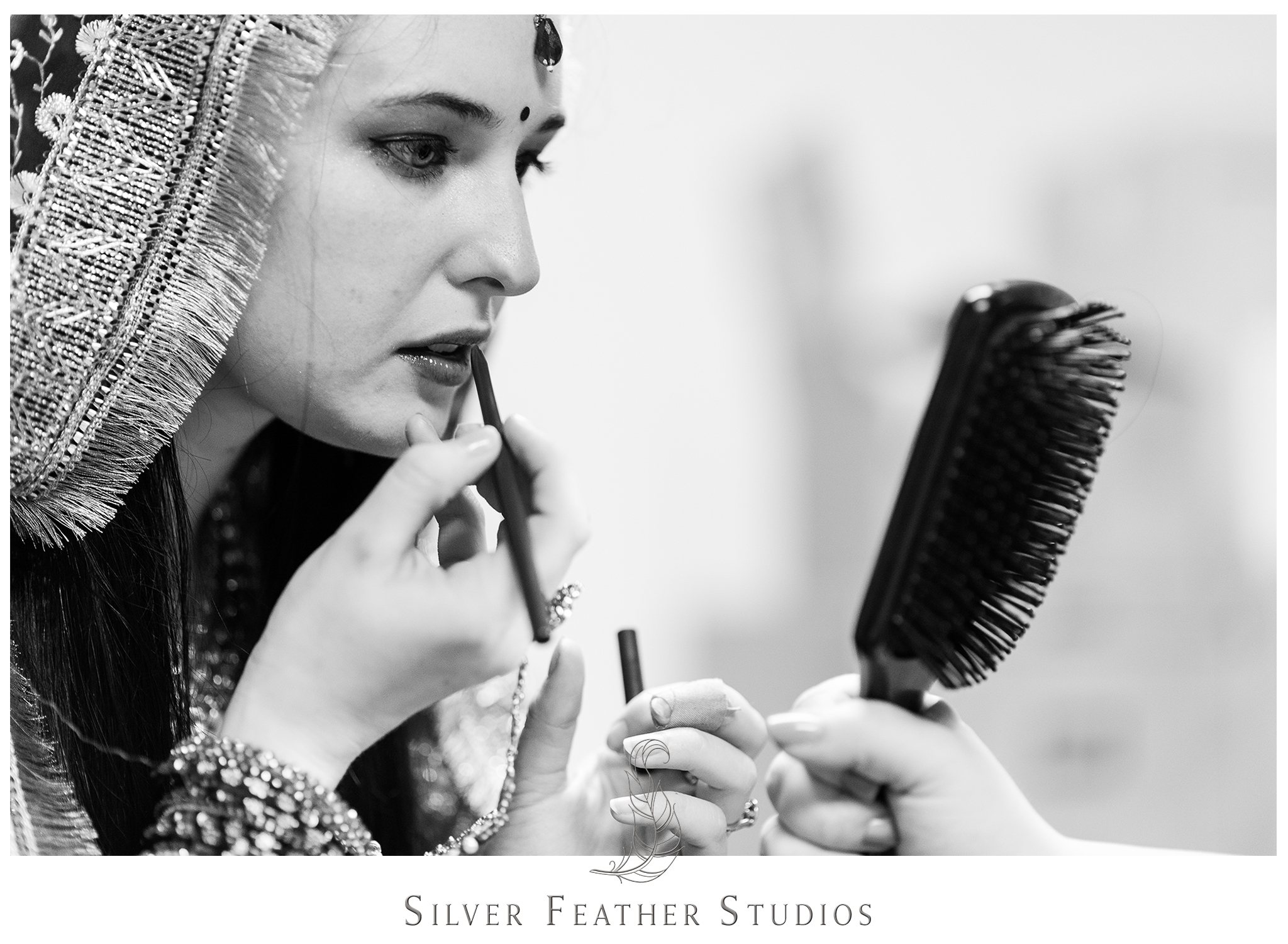 Bride puts on her makeup at her traditional Indian wedding in Raleigh, North Carolina.