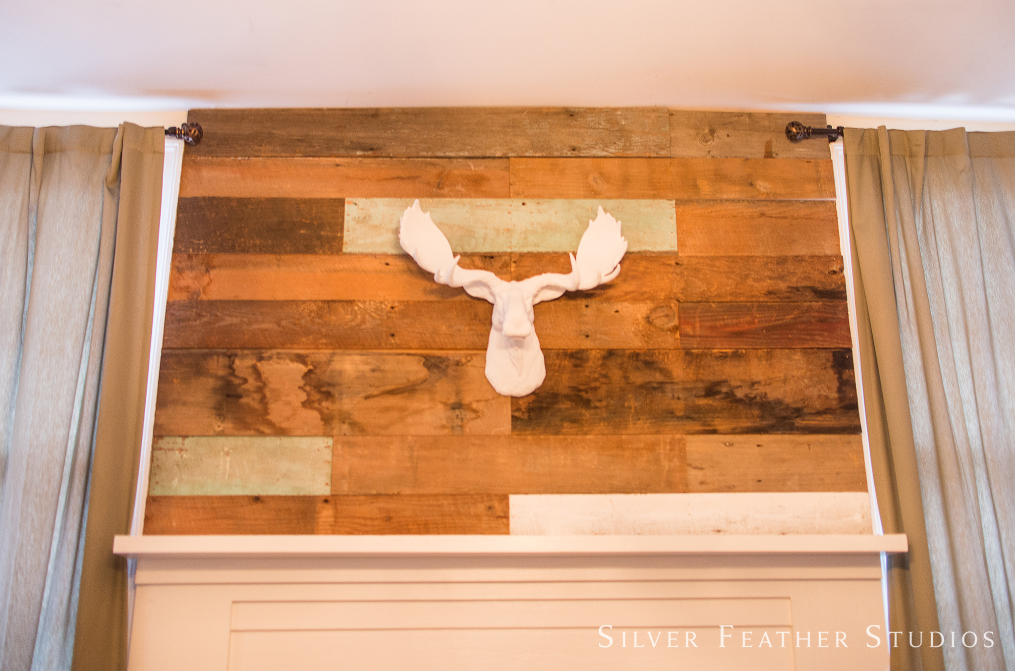 The Groom's suite features an antler wall ornament at the Mims House, a chic approach to Southern.