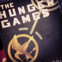 Read The Hunger Games on the flight to Seattle, WA