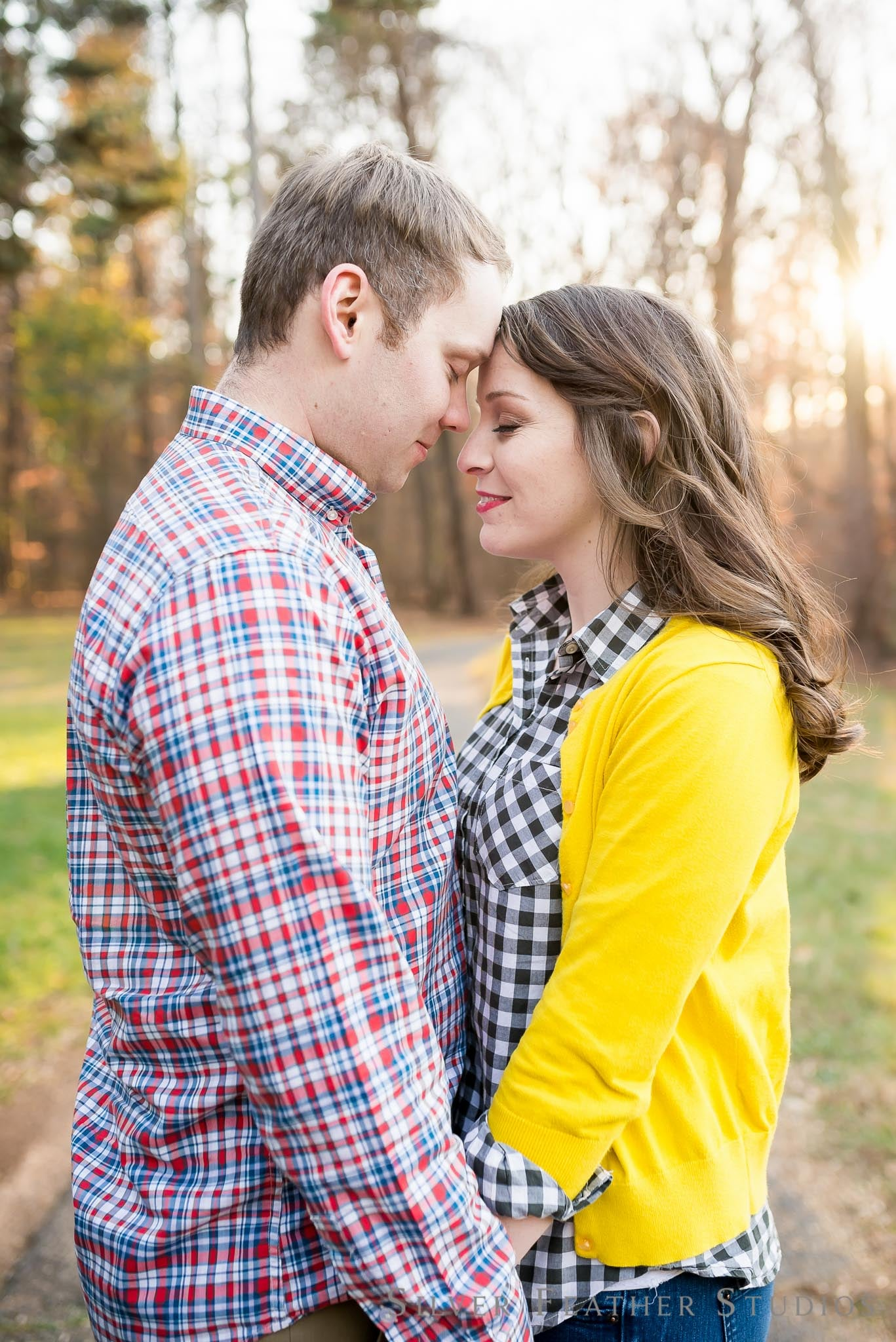 plaid and yellow outfits for this fall engagement session in greensboro.images by silver feather studios, burlington nc wedding photographer