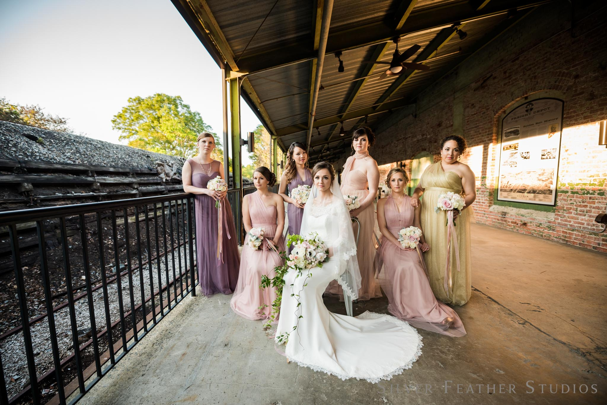 multi-colored bridesmaid dresses in rose pink, mauve, and champagne. © Silver Feather Studios, preferred vendor at the Cotton Room