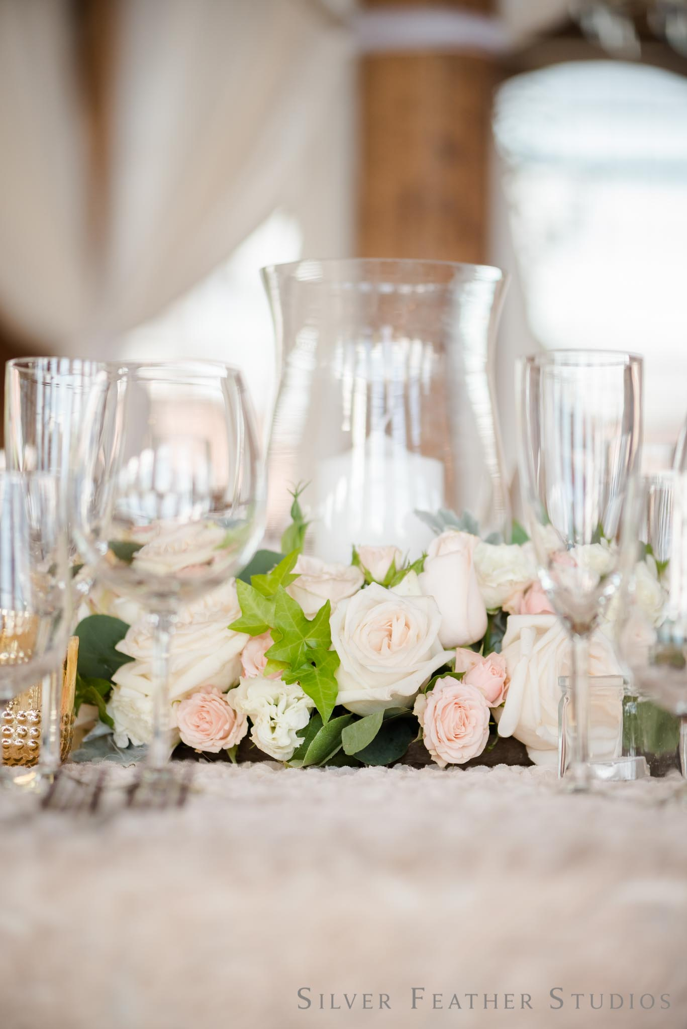 stunning pink, ivory, and champagne centerpieces by Mew Designs.   © Silver Feather Studios, Cotton Room wedding photography