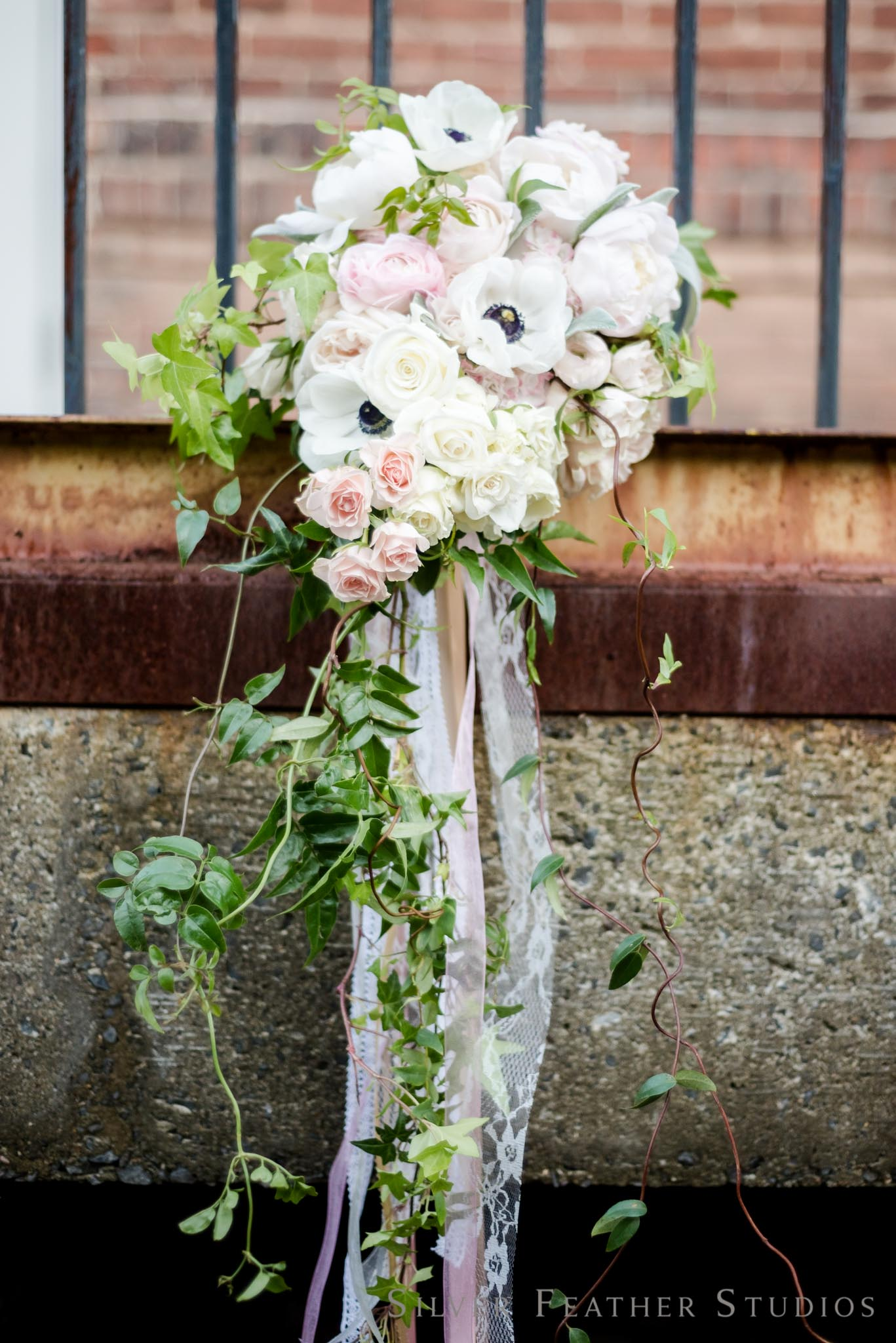 trailing bouquet  in pink and ivory by Mew Designs.   © Silver Feather Studios, wedding photographer in durham