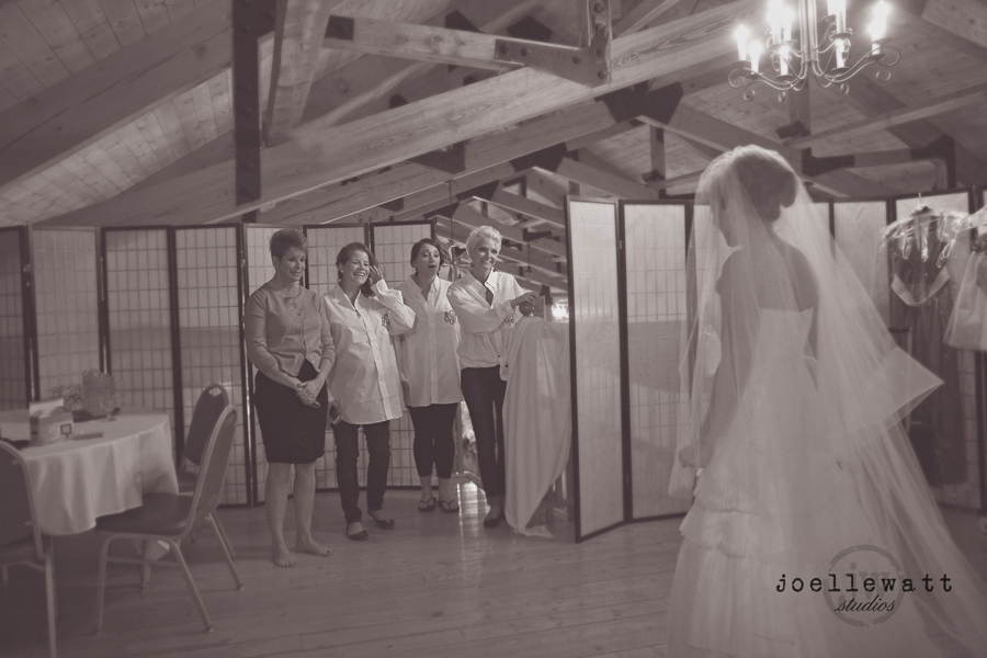 this was the first time her bridesmaids saw her in her wedding gown! priceless!