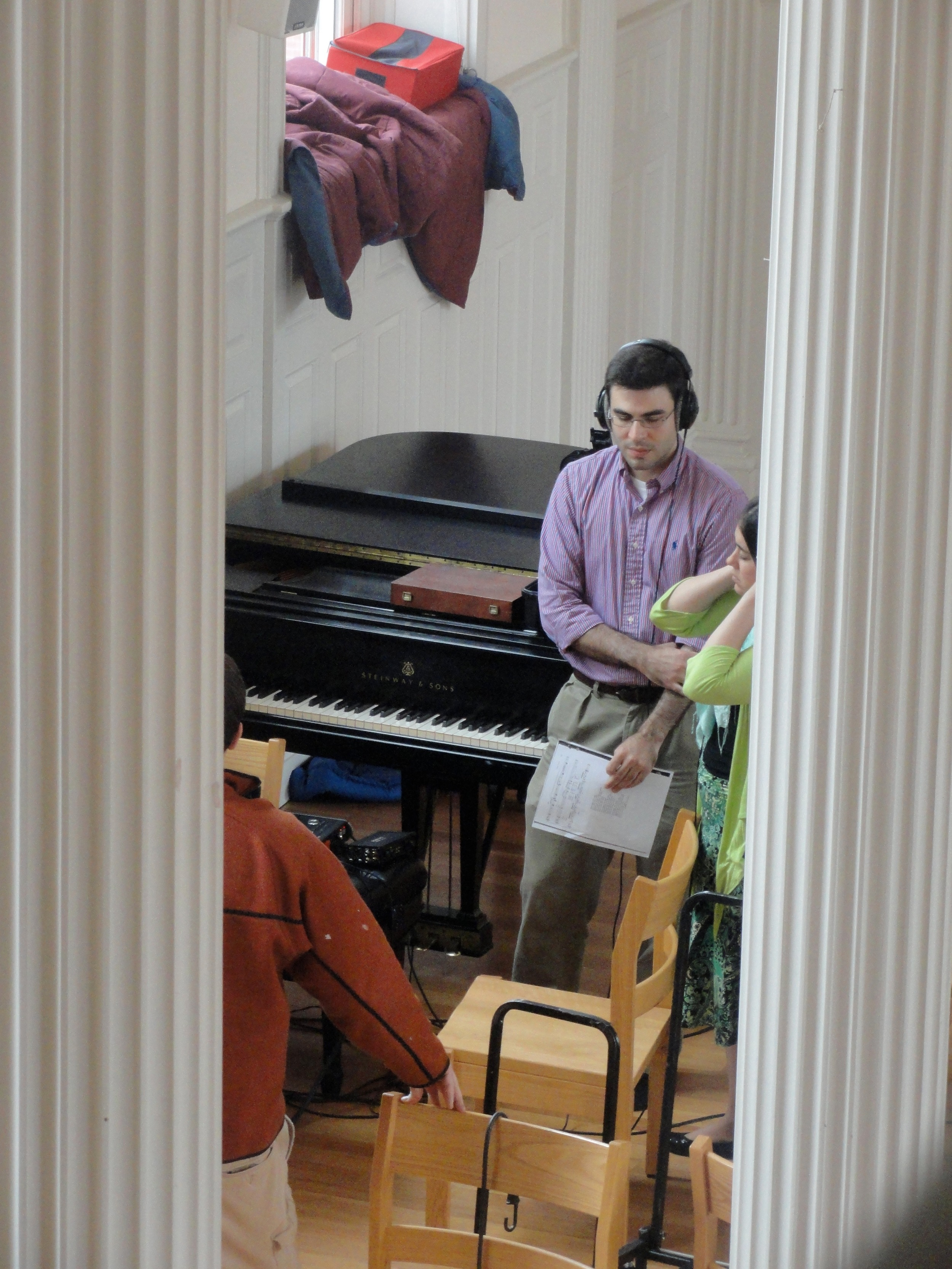 """Derek and Grace listen to a take during a recording session for """"Ceremony of Carols"""" in Marquand Chapel, Yale Divinity School"""