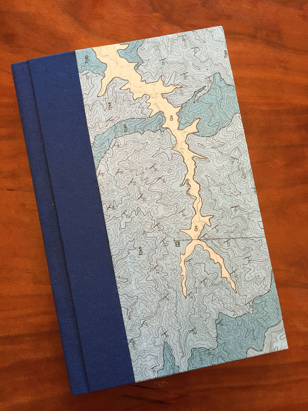 A case book I made in class with Laura Rowley. The cover is made from a geological map by Tom Diblee, who was a geologist and family friend. He walked much of California to make maps like these; they are gorgeous.
