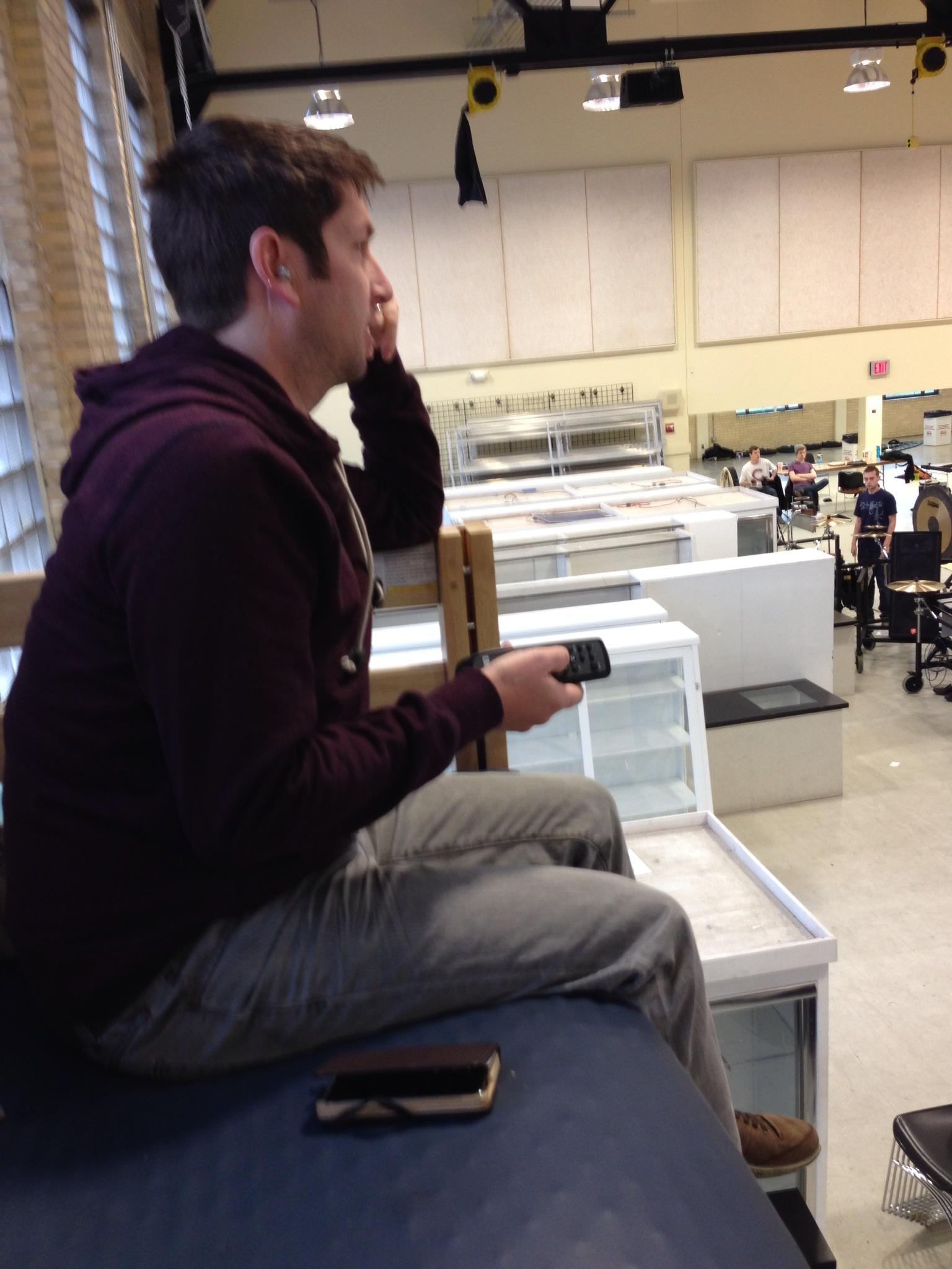 Ensemble DIrector Tim Fairbanks wearing his Music-Pro earplugs in rehearsal