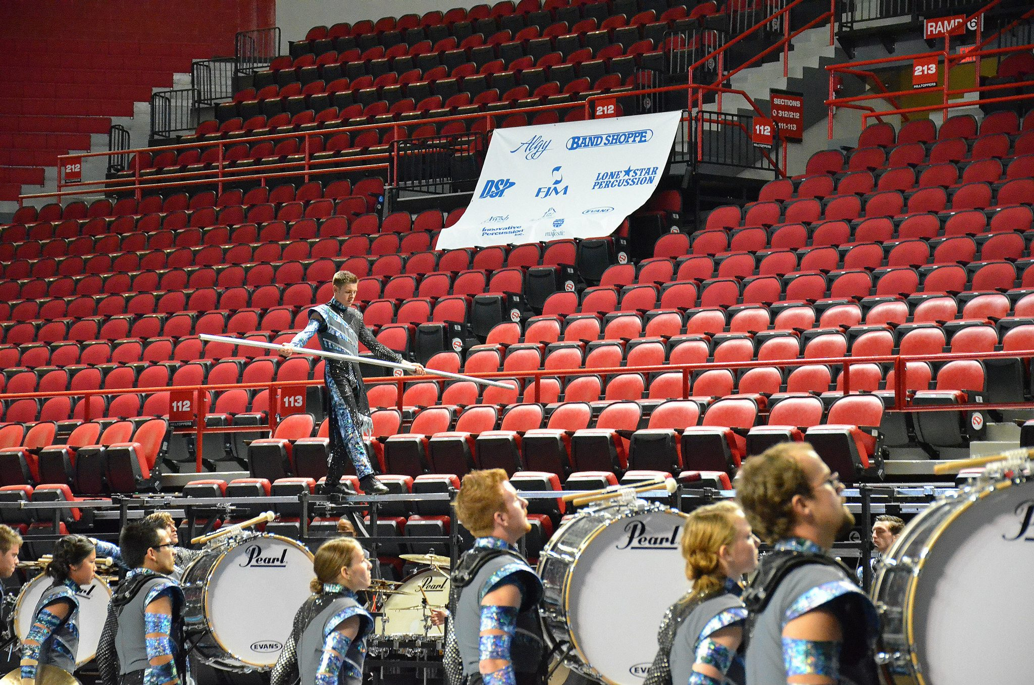 Center Snare Frankie Cummings walks the percussion rack balance beam at the WGI Mid-South Championships.
