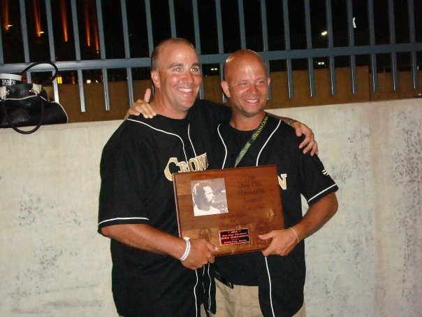 Matt and Ben holding DCI's Jim Ott Trophy for Outstanding Brass Performance. This trophy is given to the highest averaged brass score at the DCI World Championships.