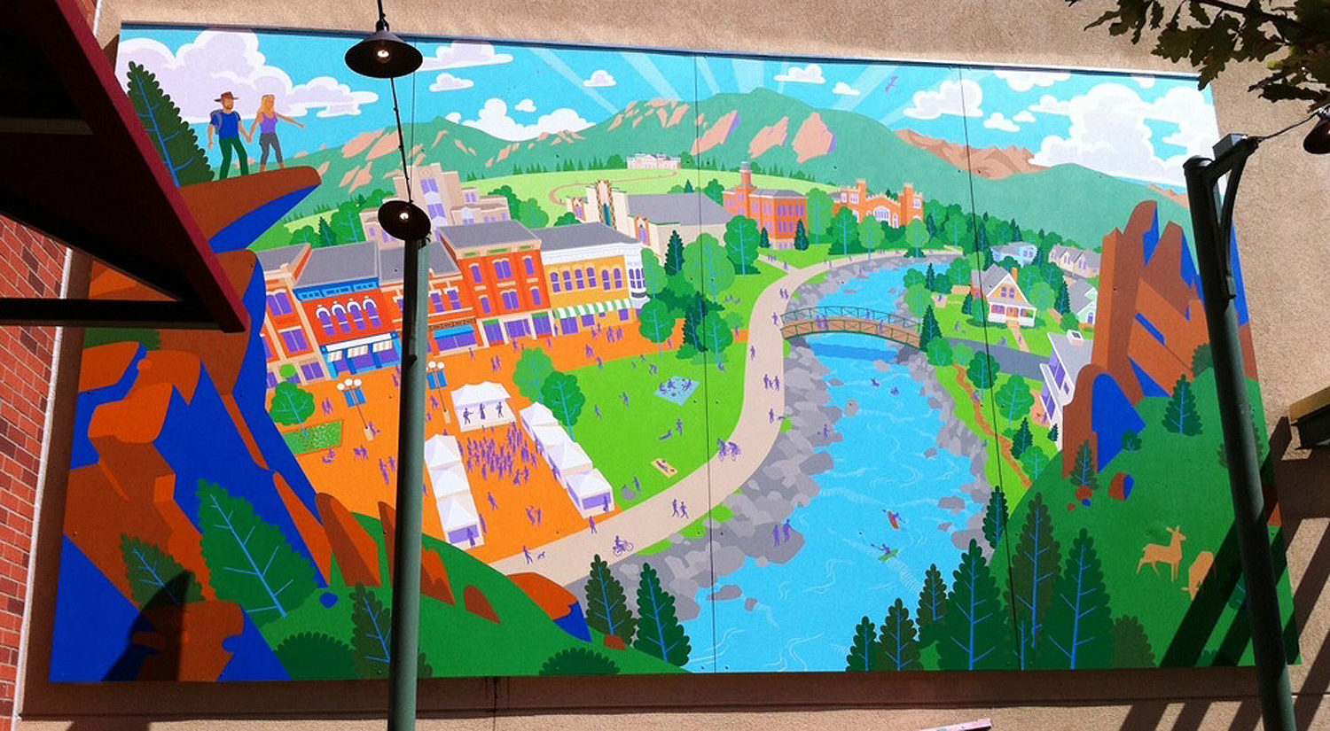 The mural is a fictional viewpoint combining many of Boulder's natural and architectural landmarks into a tribute to the town.