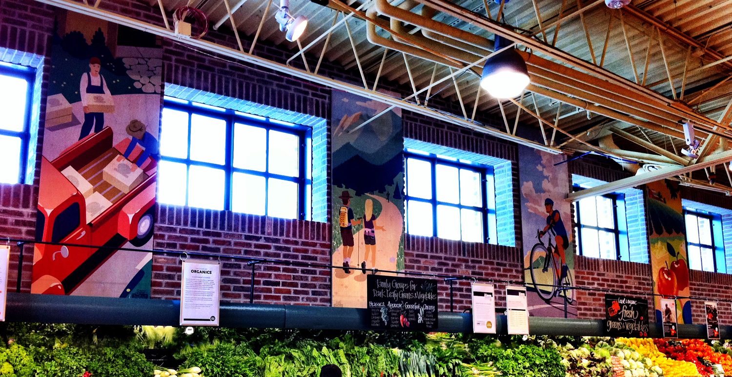 Several of the banner illustrations hang above the produce department inside the store.