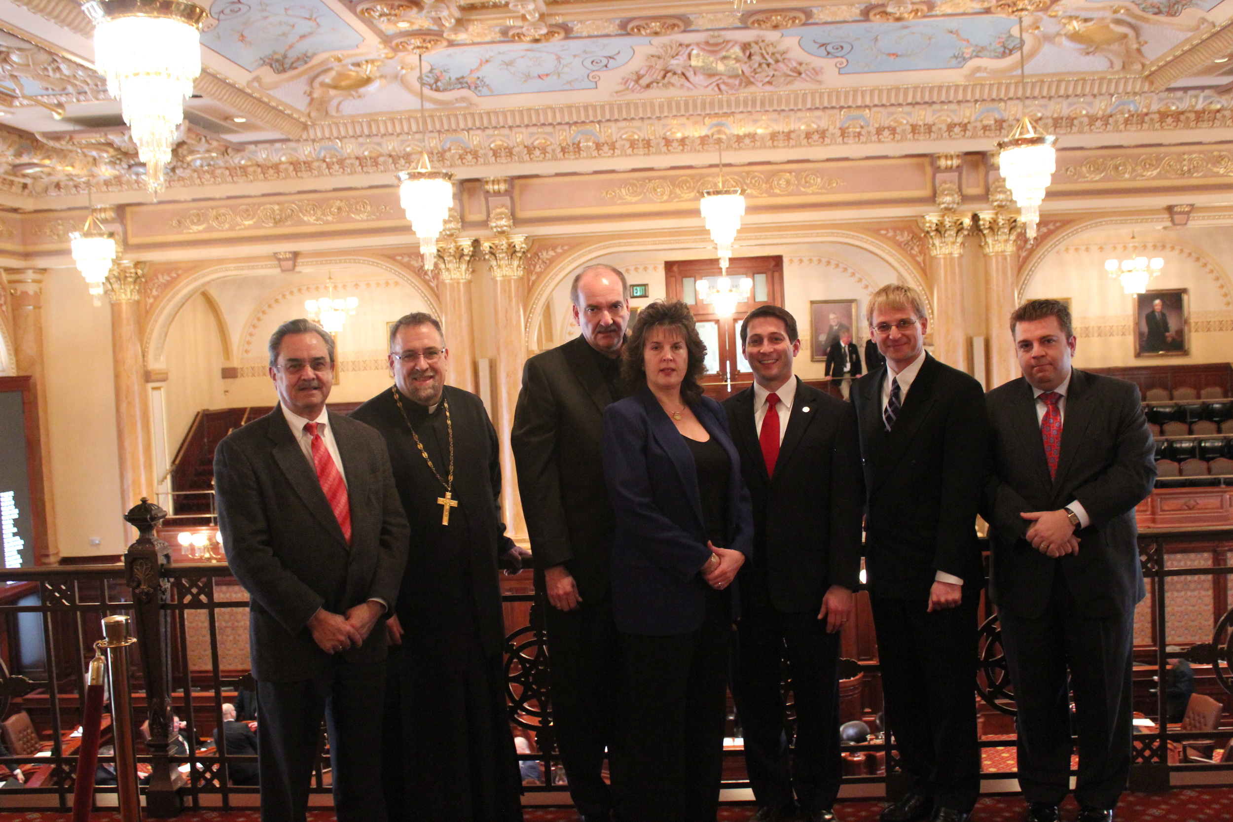 In the Balcony of the Illinois State Capitol. From left to right:Nick Xamis (Pres. Parish Council, St. Anthony GOC, Springfield, IL), Fr. George Pyle Pastor of St. Anthony, Springfield, IL, Frank and Katena Lagouros, Senator J. Barickman, John Ackerman, George Vranas (Pres. Parish Council, St. Nicholas GOC,Oak Lawn, IL) [Members of the Friends of the Ec. Patriarchate of Peoria are F. & K. Lagouros and J. Ackerman]