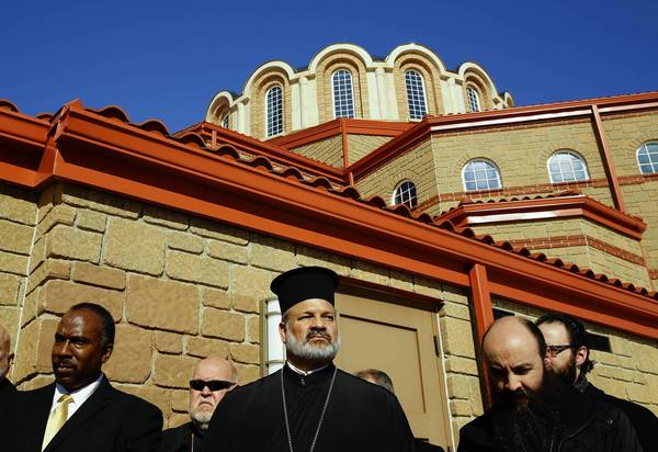 Outside St. Demetrios Greek Orthodox Church in Waukegan at a news conference addressing vandalism of the church, which occurred the same night as a similar incident at a nearby mosque. From left are Imam Matthew Ramadan of the Council of Islamic Organizations of Greater Chicago, Rev. James Gordon of Ascension of Our Lord Greek Orthodox Church in Lincolnshire, Bishop Demetrios (center) of the Greek Orthodox Metropolis, Rev. Cosmas Halekakis, pastor at St. Demetrios and Rev. Sotirios Malamis (partially hidden), of St. John the Baptist Greek Orthodox Church in Des Plaines. (Chris Walker, Chicago Tribune / February 19, 2014)