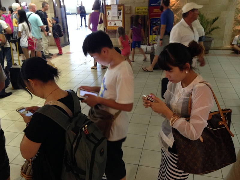 At the International airport. iDevices everywhere.