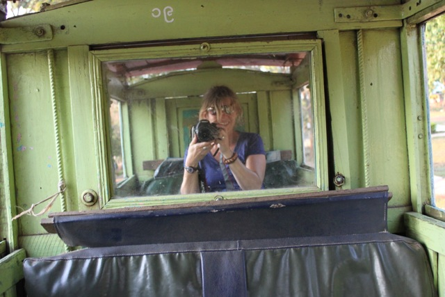 A self-portrait, taken inside a mirrored horse-drawn cart in Myanmar.  I couldn't stop smiling and I was completely alone.