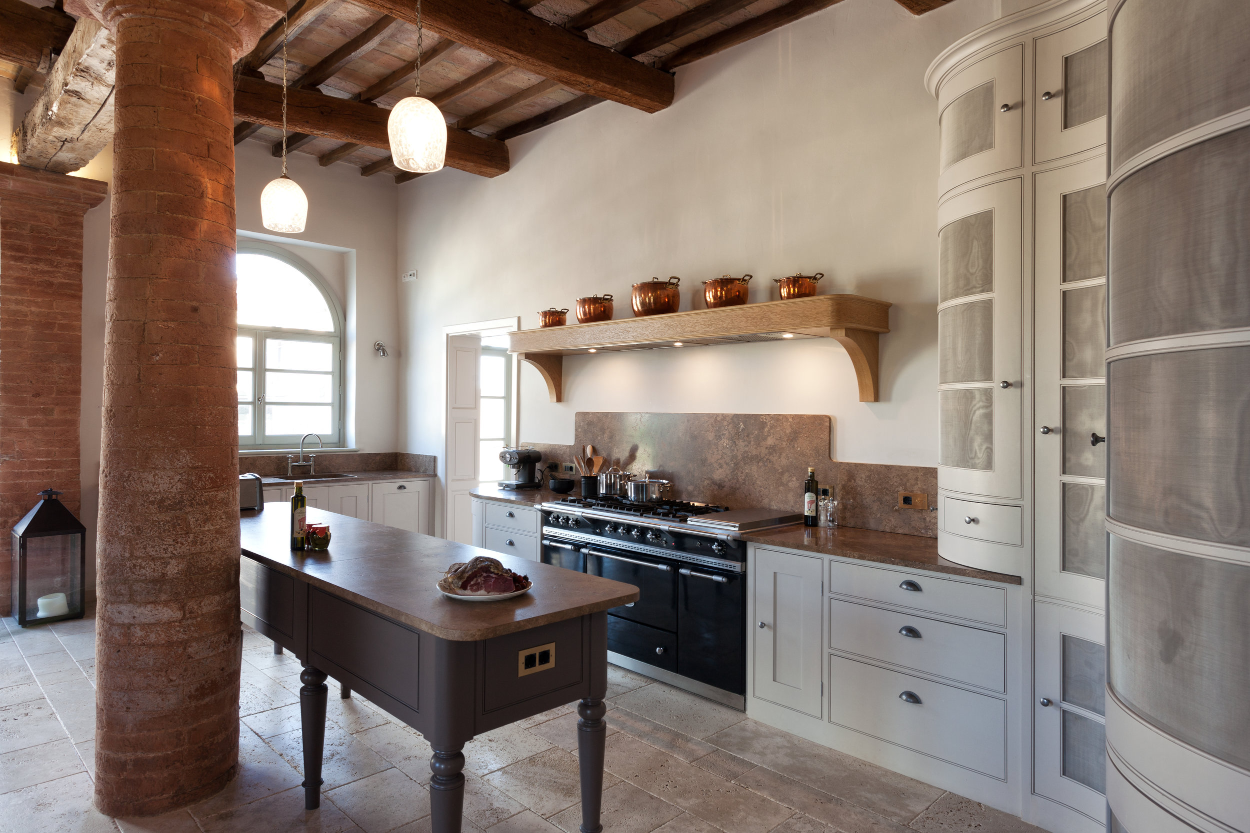 This beautiful hand crafted kitchen sits beautifully in this ancient villa