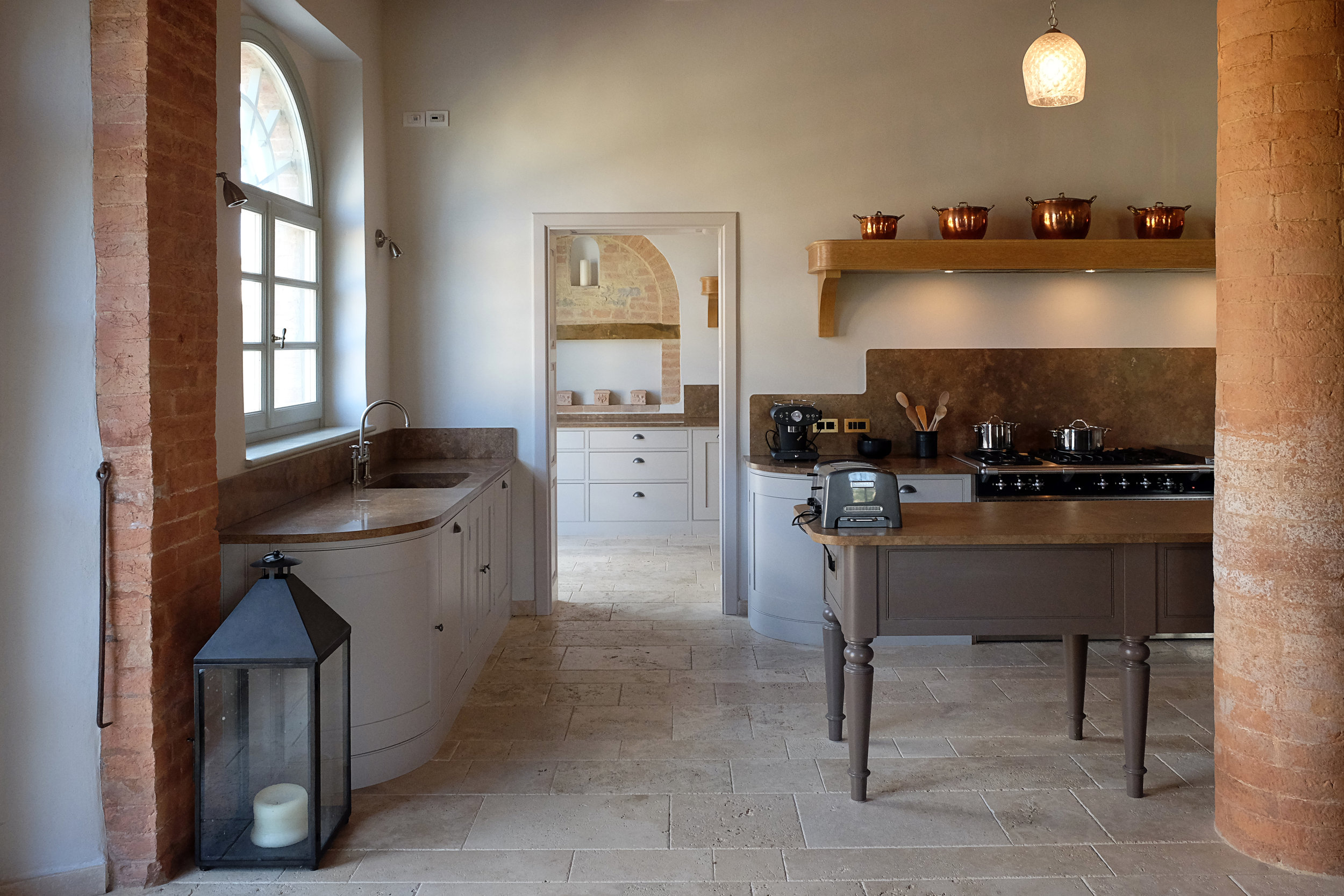 Farrow and Ball Cornforth White and London Clay compliment perfectly the natural Travertine stone floor
