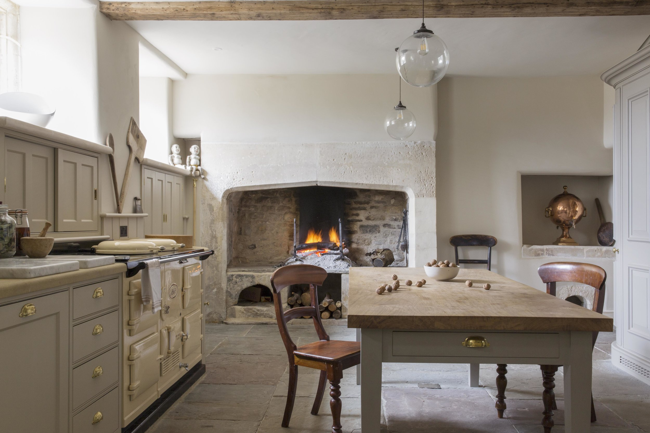 The original open fireplace adds character and authenticity.
