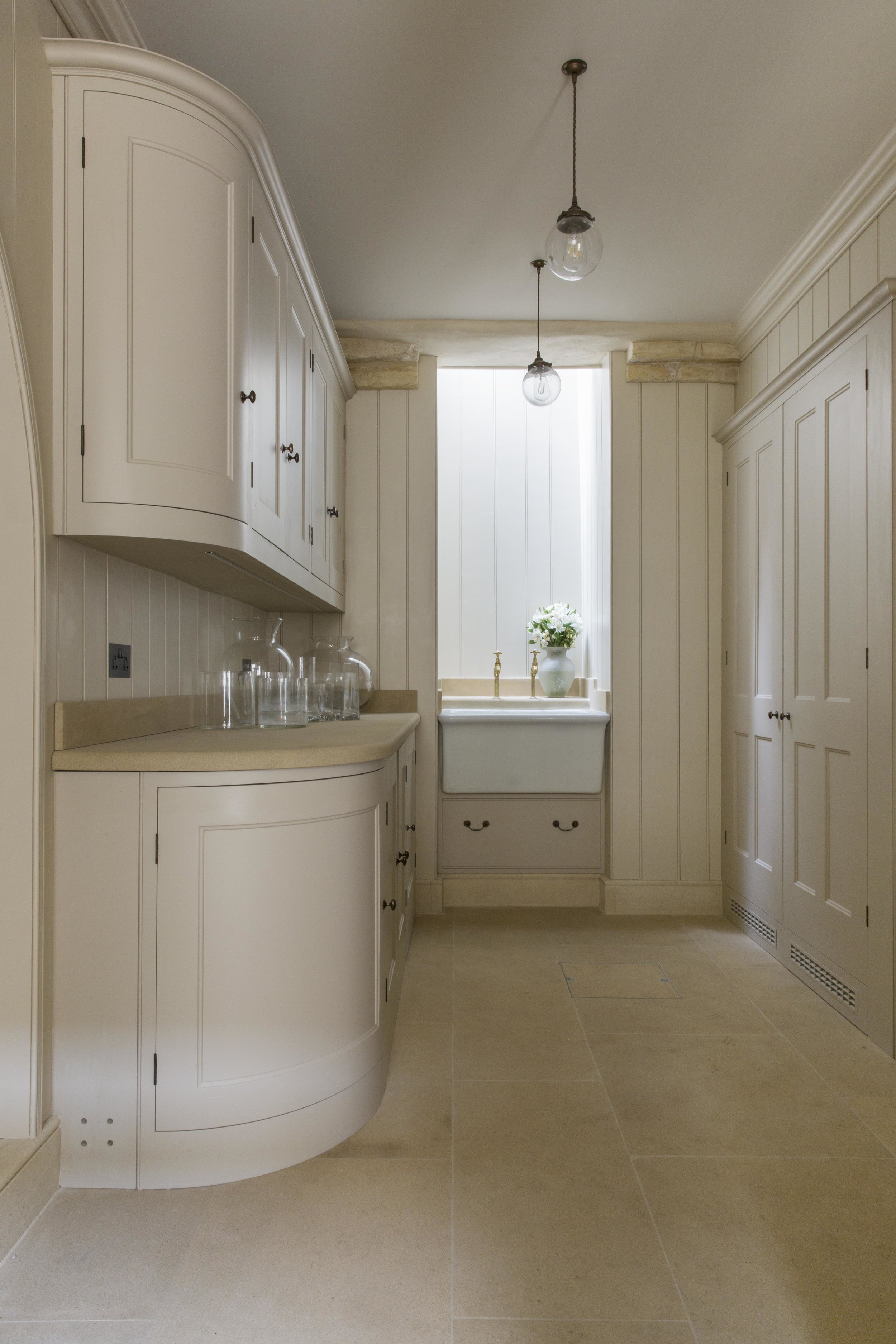 Clean lines and plain cabinetry bring a beautiful quality and simplicity to the utility room.