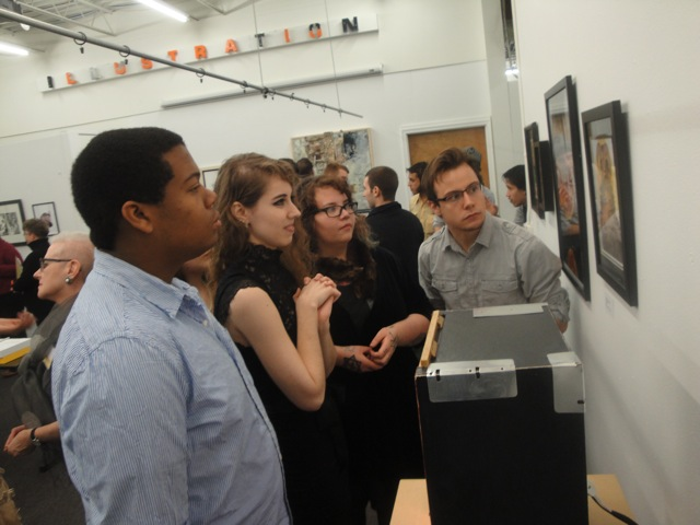 Several juniors checking out the work in the show.