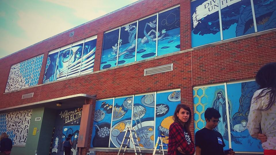 The first group installing their murals!