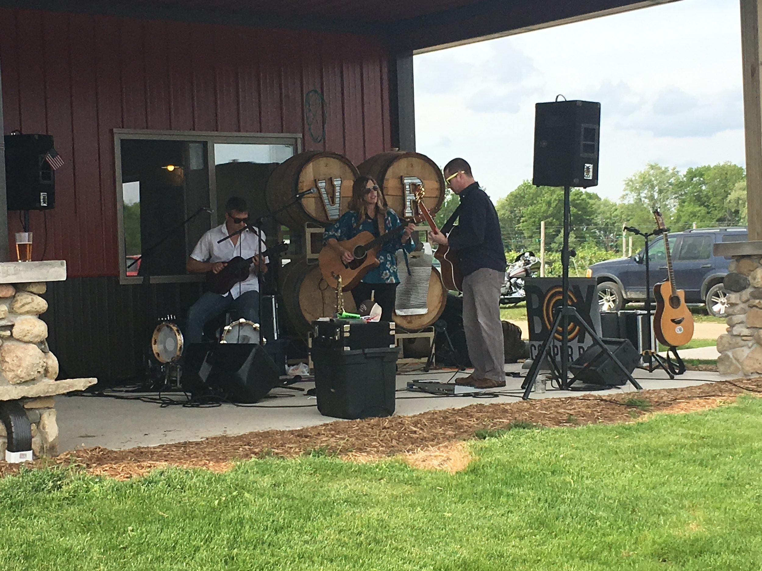 Copper Box Trio playing outside on the patio