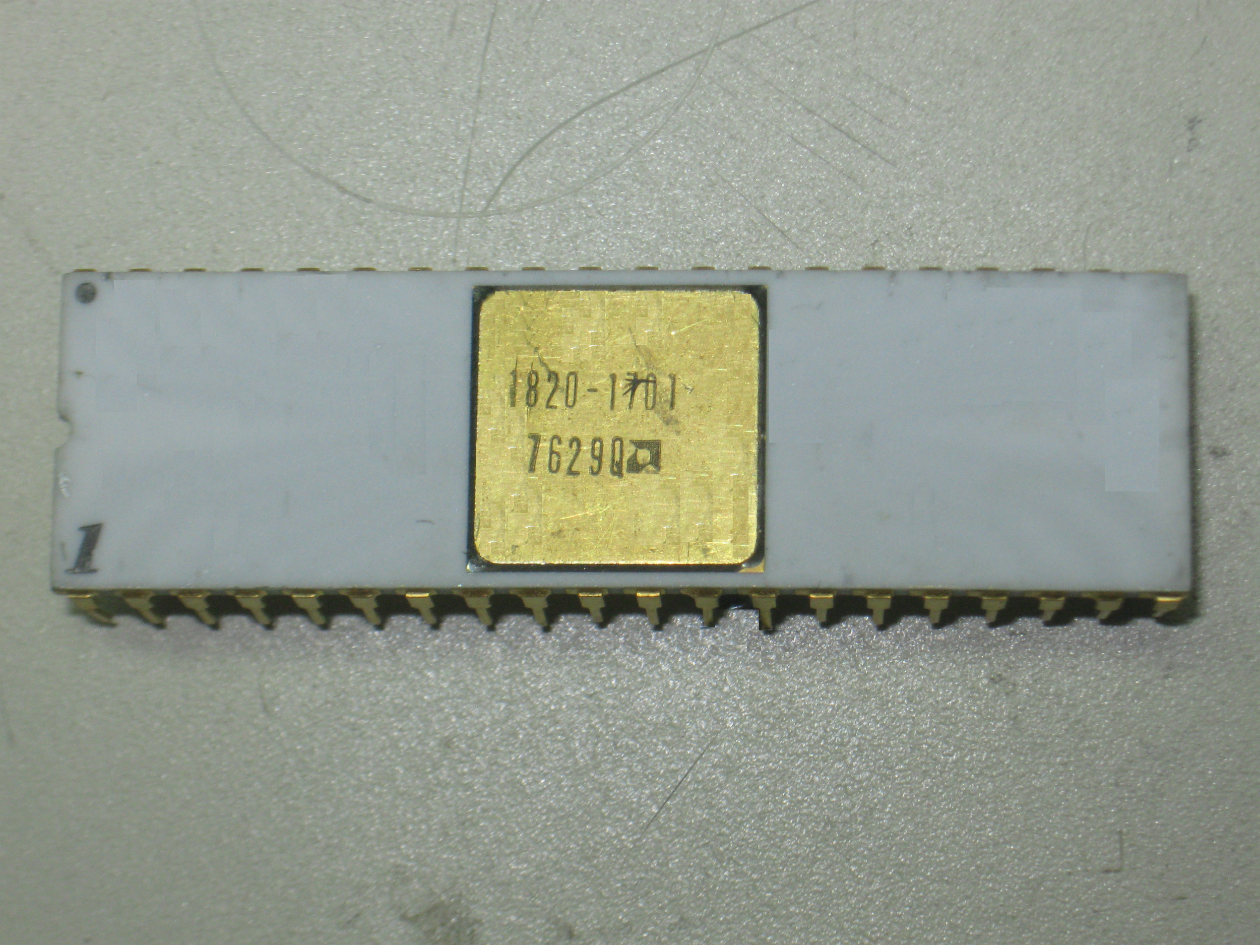 An Intel 8080 microprocessor made by AMD in the 29th week of 1976 for Hewlett-Packard under HP's part number 1820-1701. White ceramic with side welded gold plated pins and gold cover. Pin 1 is pretty obvious, but there is also a dot on pin 40 - odd.