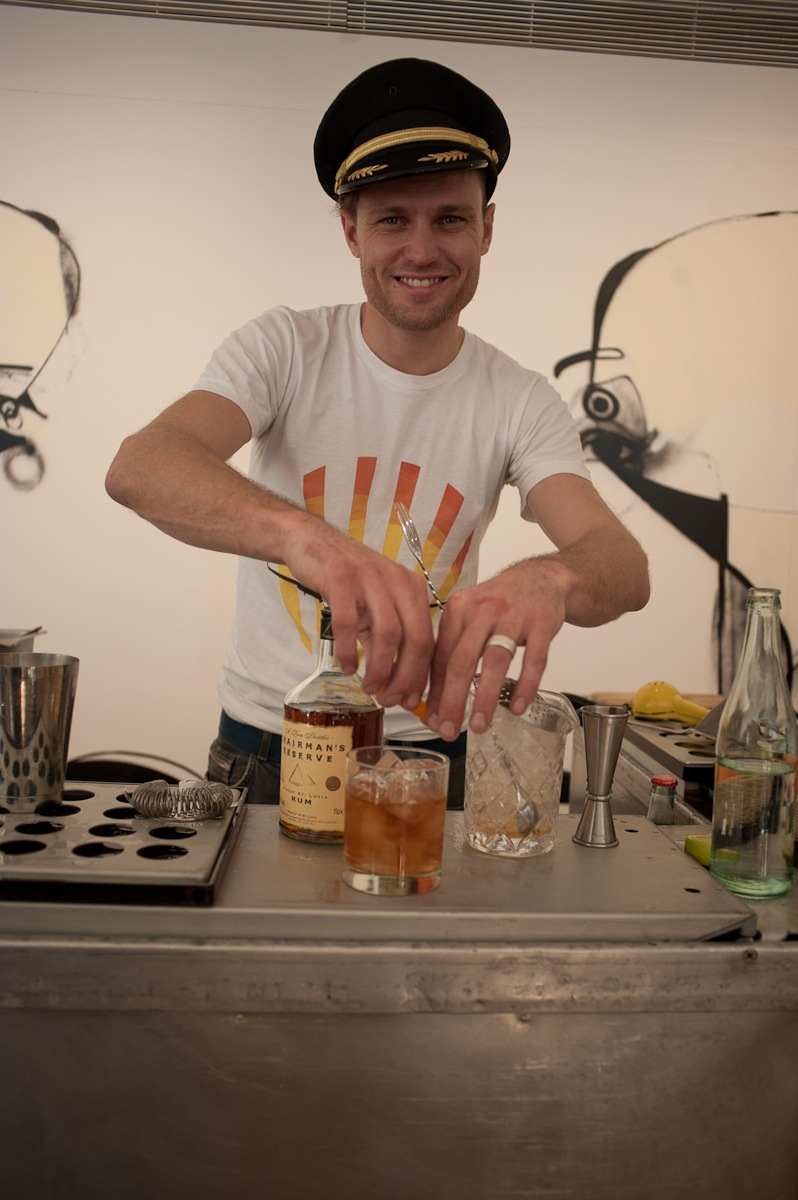 Christopher Thomas garnishing a Rum Old Fashioned.