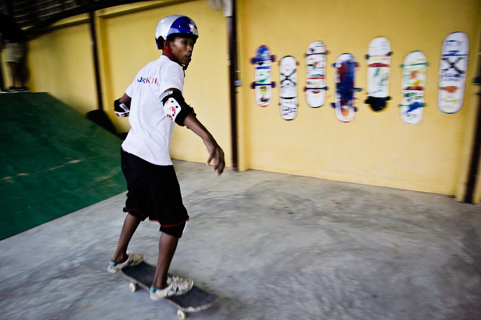 A skateboarder tries out a park run by Skateistan Cambodia, an organization that works with at-risk street kids.