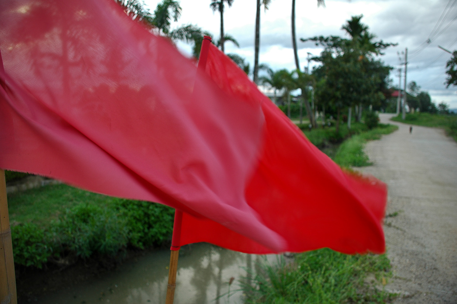Red flags wave in the wind outside a restaurant owned by a Red Shirt organizer outside Chiang Mai, Thailand.