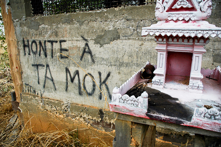 "Visitors have scrwaled graffiti over the walls of the crumbling house where Khmer Rouge official Ta Mok once lived. The graffiti reads: ""Shame on Ta Mok."""