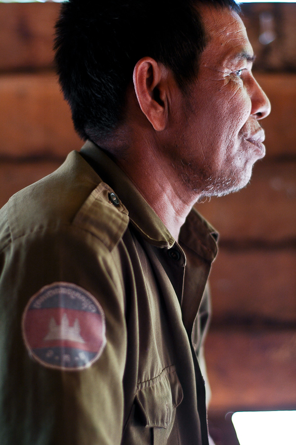 Sok Bou, 55, wears the shirt of the Cambodian army. He used to fight against the armed forces as a Khmer Rouge soldier.