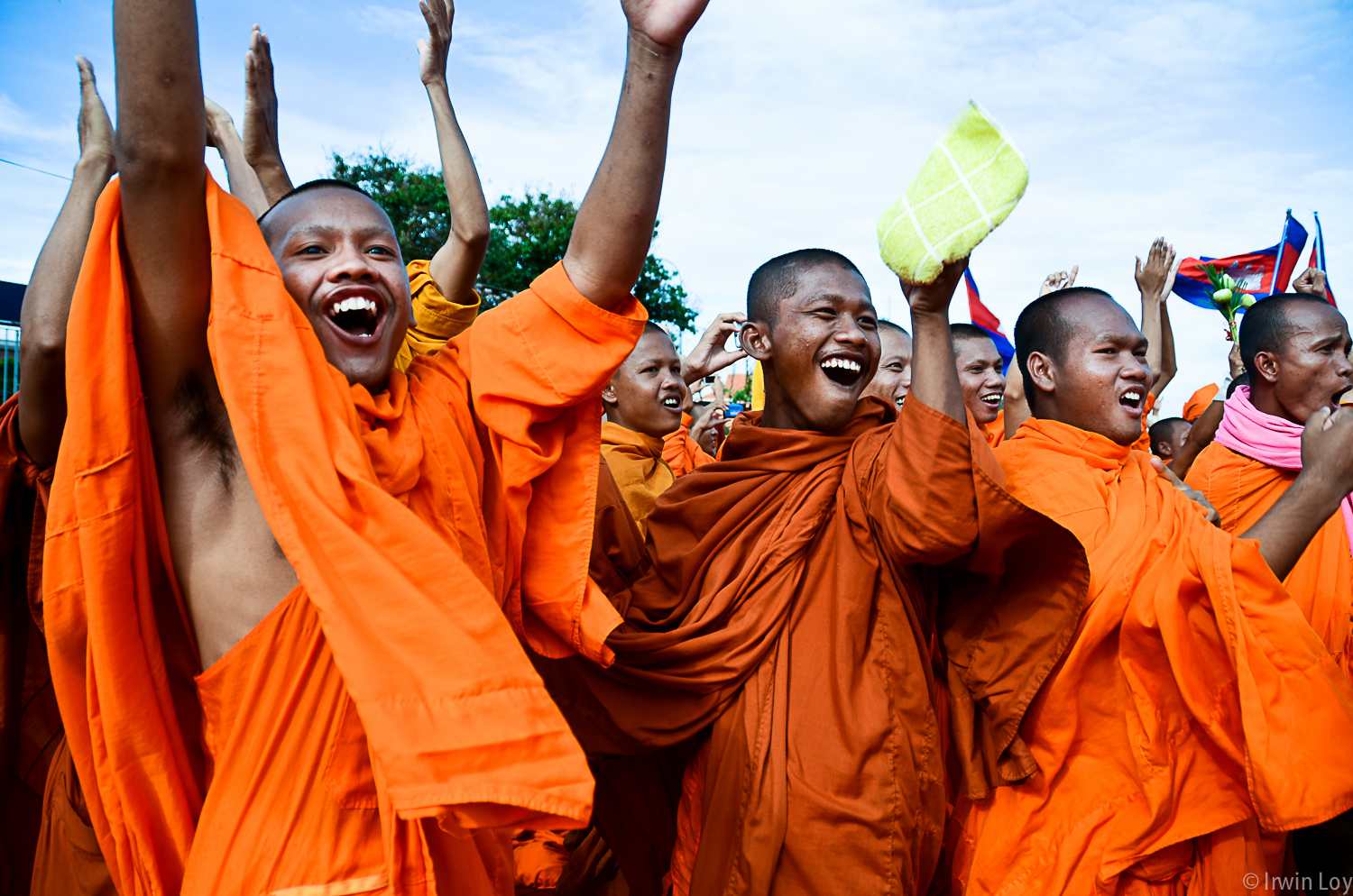 Monks celebrate when an opposition party member announces the results of negotiations with the ruling party, during an opposition-led protest September 16, 2013.