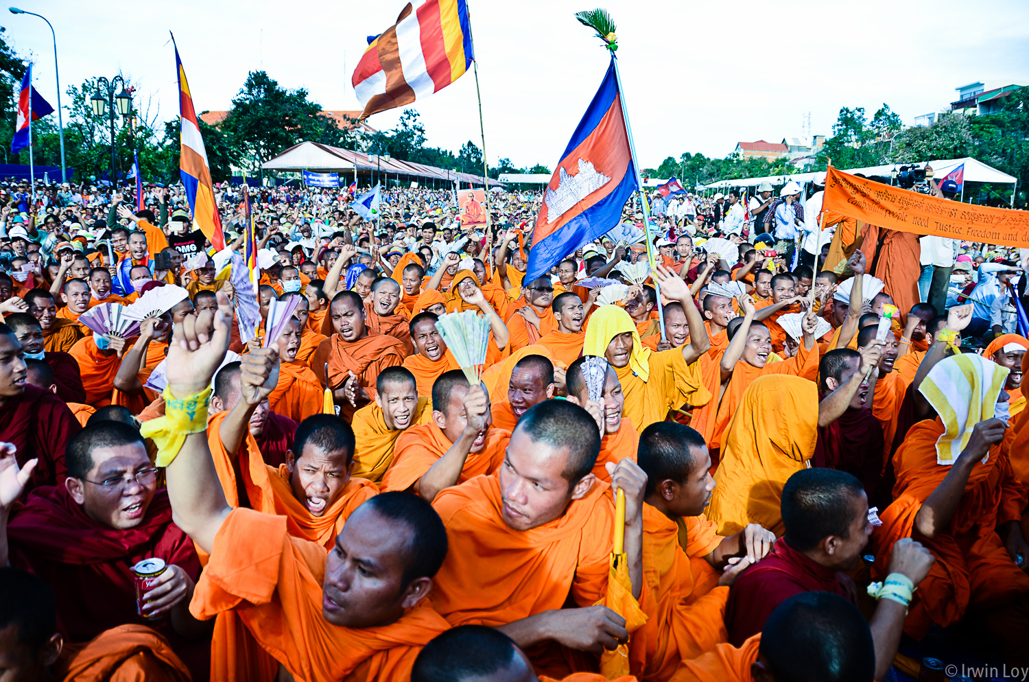 Monks sit during an opposition party rally protesting against the results of Cambodia's July 28, 2013 elections.