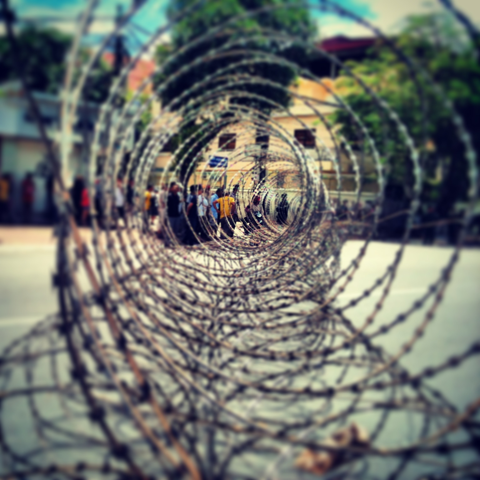 Barbed wire cordons off a section of central Phnom Penh near the residence of Prime Minister Hun Sen.