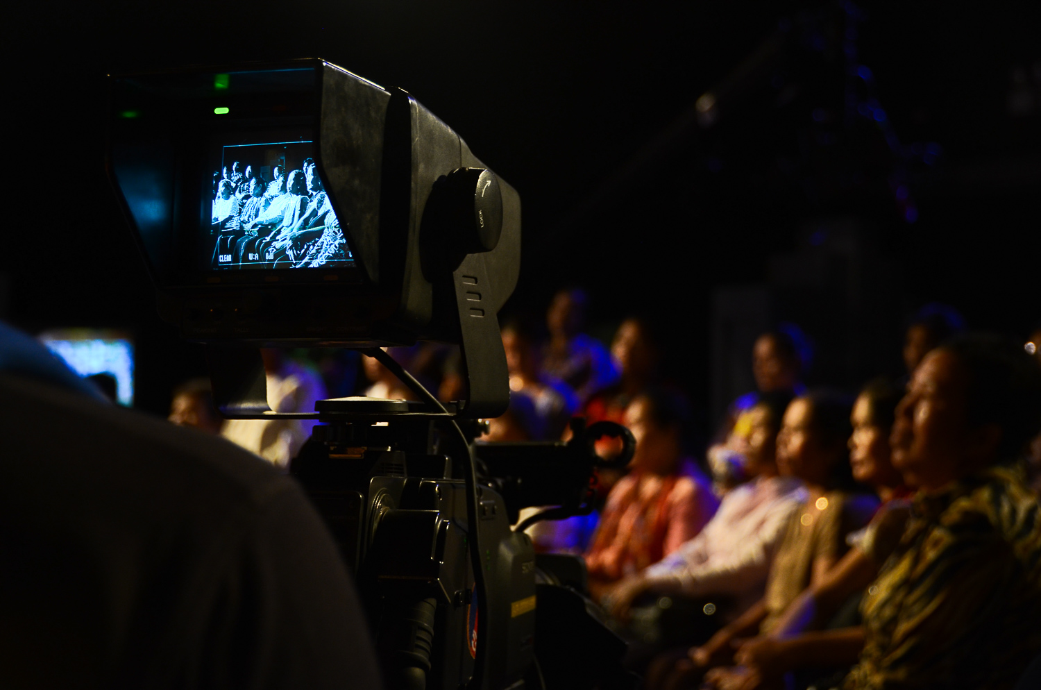 A camera pans across the audience during a taping of the reality television show, 'It's Not a Dream'.